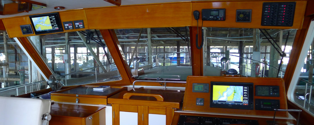 Dual display Garmin navigation system installation by Snead Island Boat Works